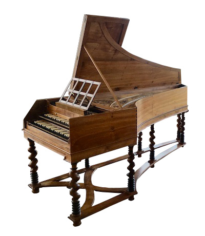 Image of a harpsichord with very fancy legs