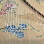 Detail of harpsichord soundboard painting.
