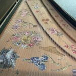 Image of a painted harpsichord soundboard.